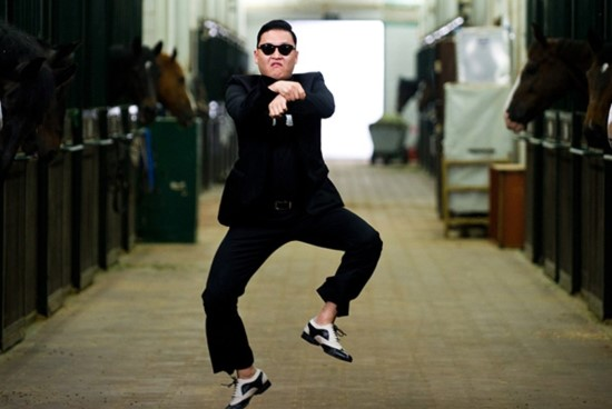 Man in black, with black sunglasses dancing Gangam Style